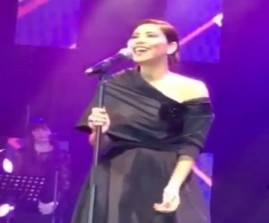 Sheren Abdel Wahab singing on the stage during her show